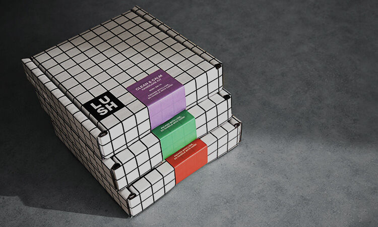 Three white and black boxes with a checkered pattern and colorful tags stacked on top of each other on a grey background