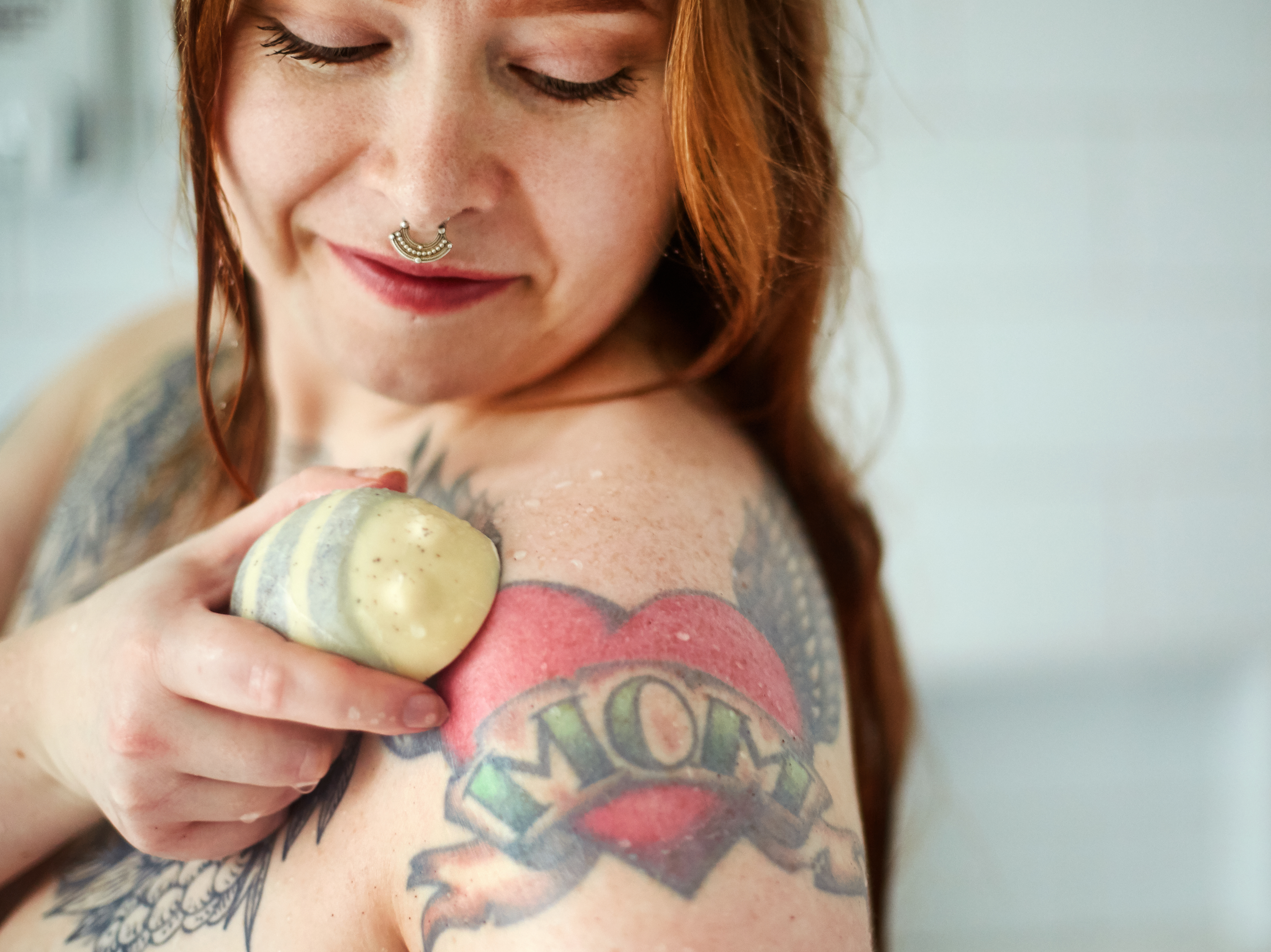 A woman rubs Scrubee into her skin.