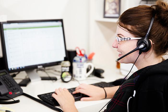 A Lush employee answering calls.