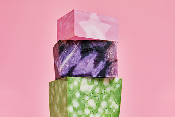 Three bar soaps stacked on top of each other. height=