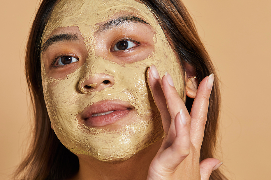 A person applying Brush Strokes Fresh Face Mask to their face.