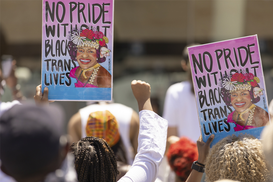 Demonstrators at the 2015 Brooklyn Rally holding signs honoring legendary activist Marsha P. Johnson.