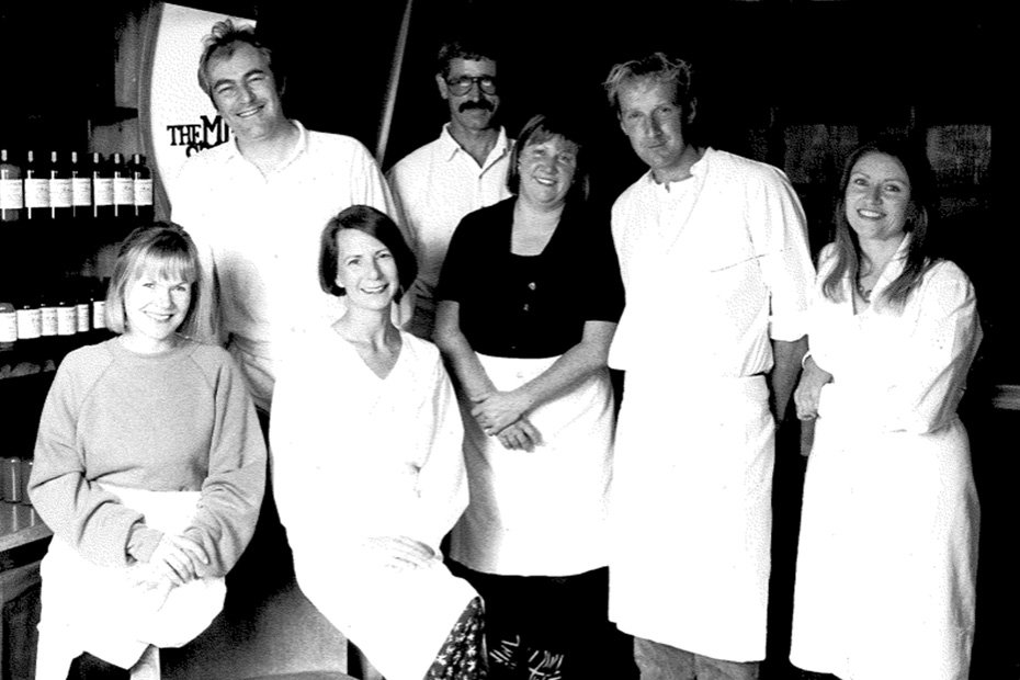 A black and white photo of Lush's founders posing for the camera.