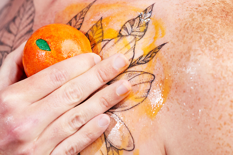 A person runs Easy Peeler Body Scrub on their chest.