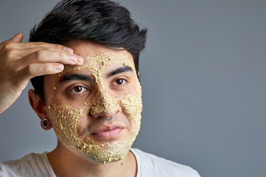 Nathan applying an oatmeal face mask